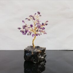 Amethyst tree of life wire sculpture on turf