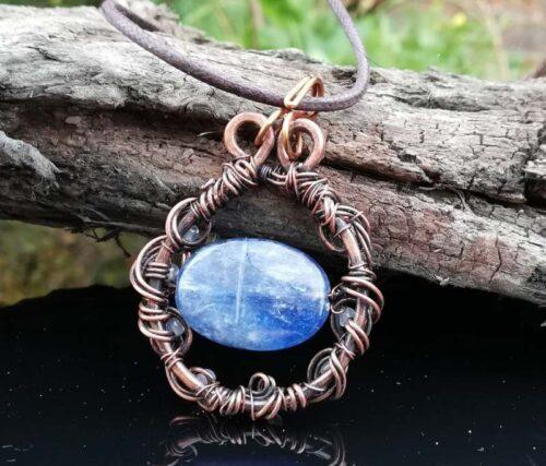 blue kyanite stone in copper wire jewellery pendant