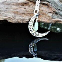crescent moon emerald pendant
